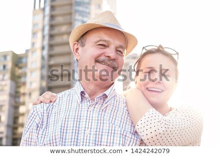 Coppia · affettuoso · bere · sedia · holding · hands · romance - foto d'archivio © stockyimages