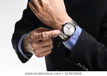 Businessman angrily pointing to his watch Stock photo © photography33