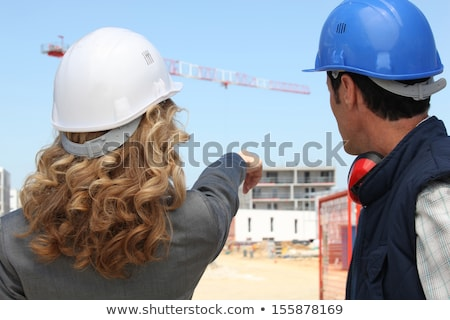 Tradesman and an engineer working together on a construction site Stock photo © photography33