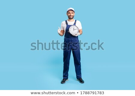plumber holding up a clock stock photo © photography33
