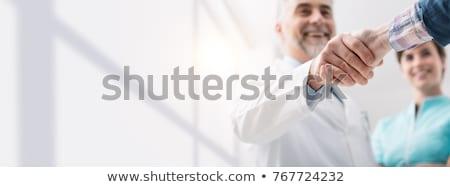 счастливым практикующий врач лице врач медицинской волос Сток-фото © photography33