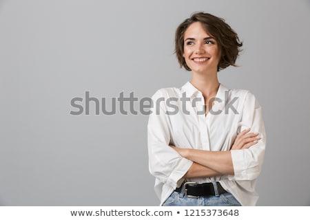 jonge · brunette · vrouw · jeans · zwarte · top - stockfoto © acidgrey