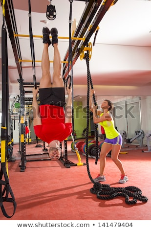 Stock photo: Crossfit dip ring woman workout at gym dipping