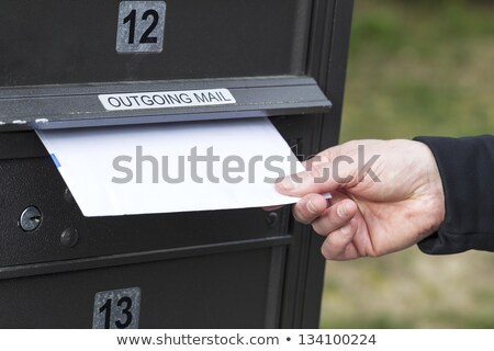 Putting Letter in Outgoing Postal Mailbox  Stock photo © tab62