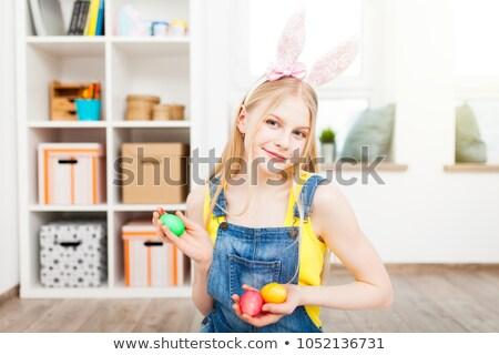 szőke · nő · festett · vicces · húsvéti · tojás · csinos - stock fotó © Pasiphae