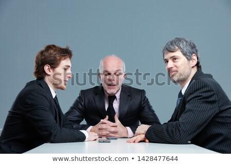 stílusos · üzletember · mutat · ujj · beszél · fehér - stock fotó © smithore