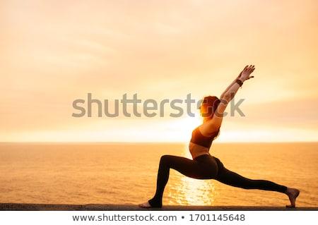 Yoga kadın gün batımı meditasyon güneş açık havada Stok fotoğraf © HASLOO