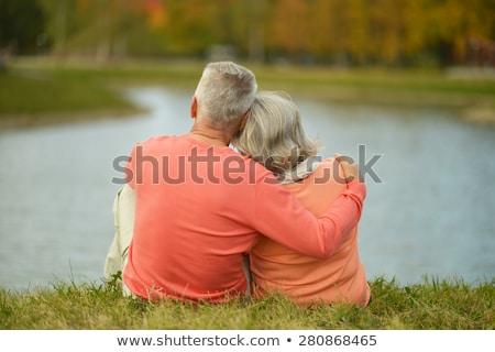 Idős emberek park kettő kopott boldog emberek szeretet Stock fotó © Kurhan