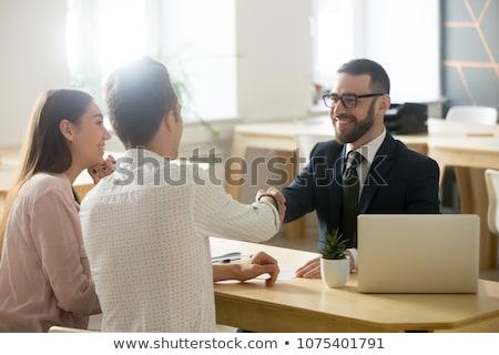 Lächelnd jungen Geschäftsmann Gruß Stock foto © feedough