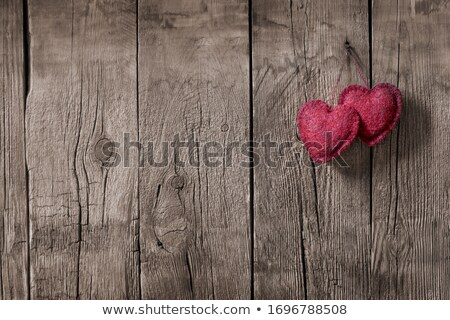 red heart symbol on a rustic wooden planks stock photo © justinb
