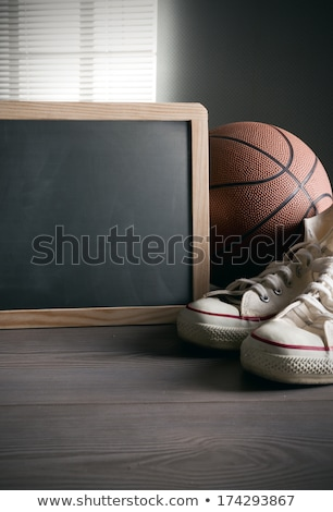 blackboard with canvas shoes and basketball stock photo © stokkete