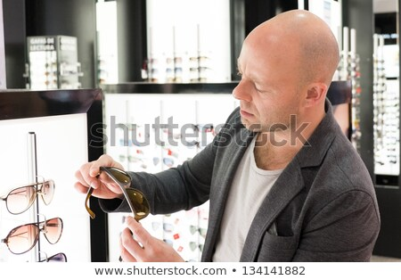 Middle-aged man choosing clothes in a shopping mall  Stock photo © Nejron
