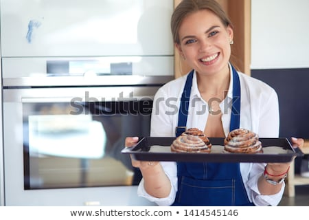 Woman hands holding plate with homemade baked goods Stock photo © Nejron