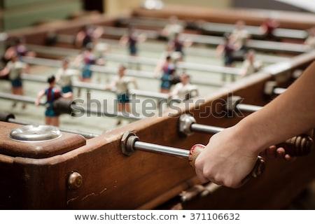 mesa · partido · de · fútbol · macro · rojo · amarillo · jugadores - foto stock © franky242