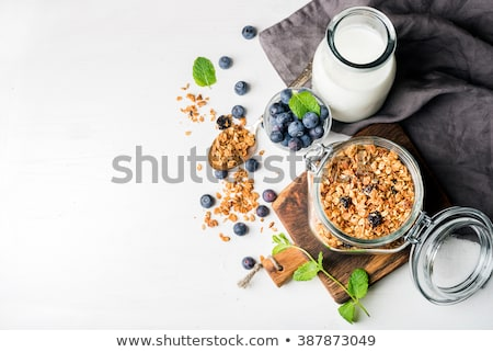 Fresh fruit and oatmeal with healthy toppings for breakfast Stock photo © martince2