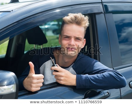 Smiling Teenage Boy In Car Passing Driving Exam Stock photo © HighwayStarz