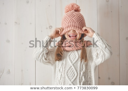 young woman knitting a scarf and smiling stock photo © deandrobot