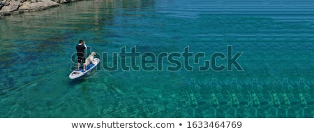 senior male on stand up paddling sup board stock photo © pixelsaway