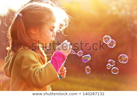 little girl playing on a meadow stock photo © maros_b