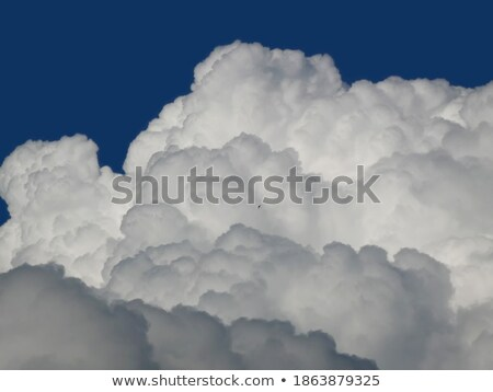 Fleecy clouds against a background blue sky Stock photo © All32