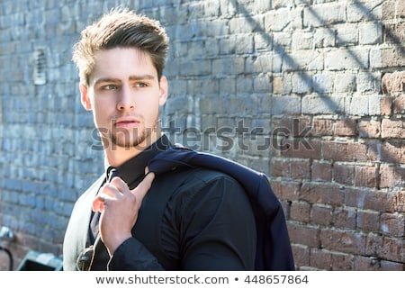 handsome young business man closing his jacket Stock photo © feedough