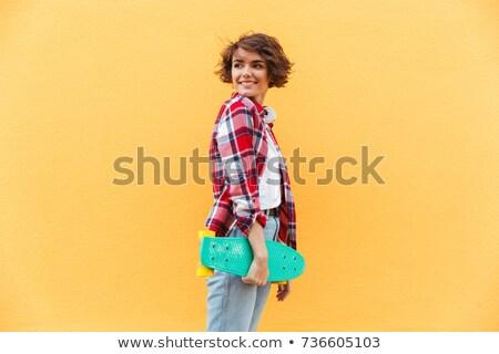 Gyönyörű női görkorcsolyázó másfelé néz teljes alakos portré Stock fotó © deandrobot