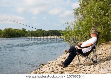 Landscape with a chair fisherman and water Stock photo © AlisLuch