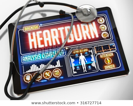 Stock photo: Heartburn on the Display of Medical Tablet.