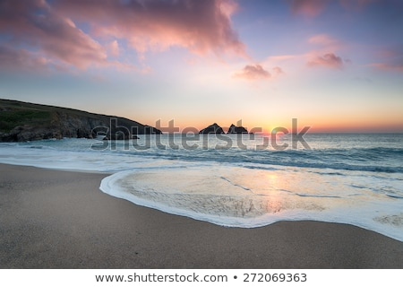 Naplemente tengerpart Cornwall Anglia hullám sziluett Stock fotó © chris2766
