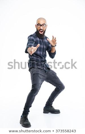 Vicces fiatal afroamerikai férfi mutat karate Stock fotó © deandrobot