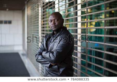 Security Guard Standing Arms Crossed In Front Of Gate Stock photo © AndreyPopov