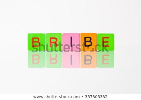 Bribe - an inscription from children's blocks Stock photo © CaptureLight