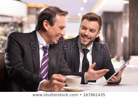 business man with tablet in restaurant stock photo © kzenon