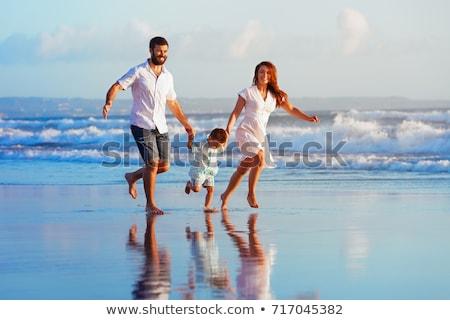 Láb apa fia nedves homok tengerpart család Stock fotó © meinzahn
