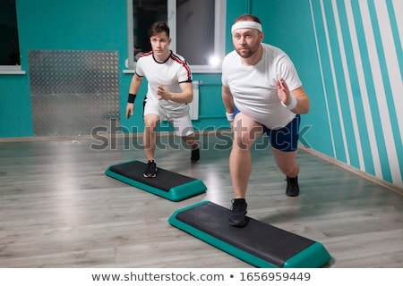 Fat man doing workout Stock photo © pedromonteiro