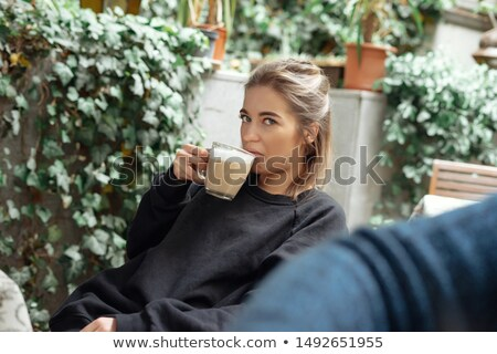 Disgusted woman gesturing to cup of tea Stock photo © ozgur