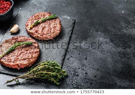 grillezett · marhahús · hamburger · vágódeszka · hús · föld - stock fotó © Digifoodstock