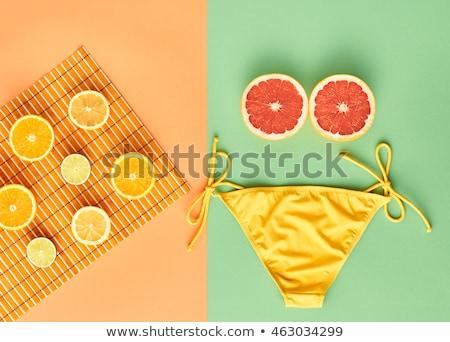 Бикини грейпфрут красивой pinup модели бикини Сток-фото © Fisher