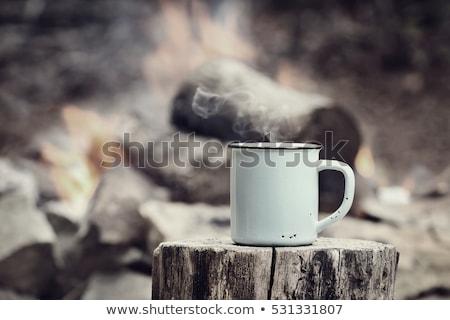 Vintage copo café fogueira quente sessão Foto stock © StephanieFrey
