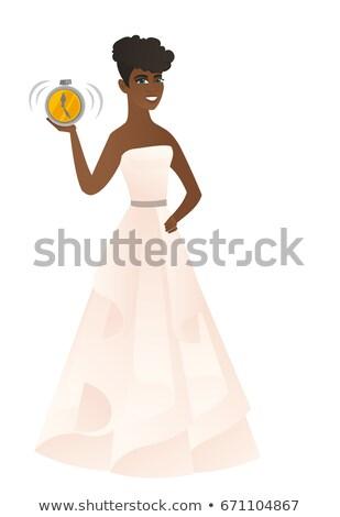 African-american fiancee holding alarm clock. Stock photo © RAStudio
