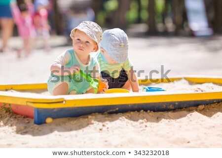 The Two Little Baby Girls Playing At Outdoor Playground Foto d'archivio © Len44ik