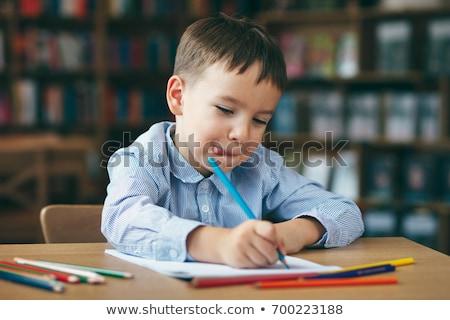 Souriant écolier devoirs bibliothèque école crayon Photo stock © wavebreak_media
