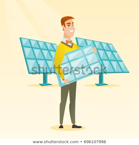 Young caucasian worker of solar power plant. Stock photo © RAStudio
