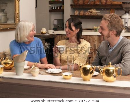 maduro · casal · padaria · mulher · comida · compras - foto stock © is2