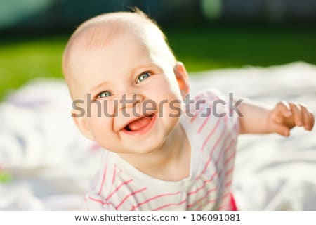 Baby smiling with mouth open, close-up Stock photo © IS2