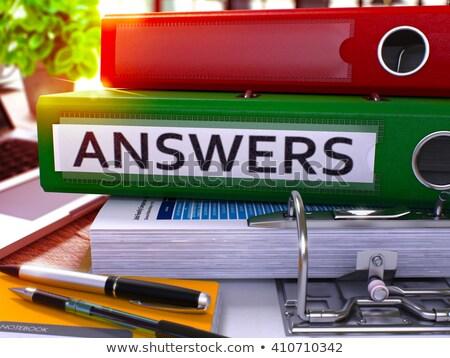 Green Office Folder with Inscription Answers. Stock photo © tashatuvango