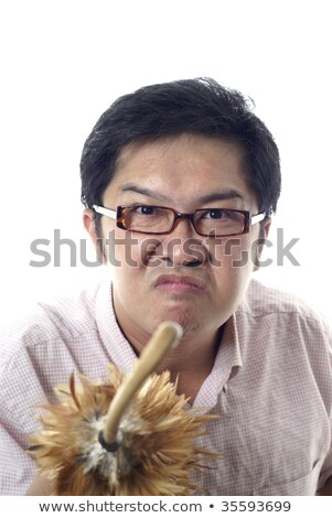 Angry teacher with feather duster cane on white background Stock photo © palangsi