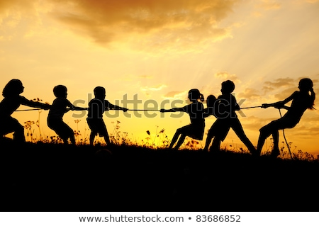 Background scene with children playing tug of war Stock photo © bluering
