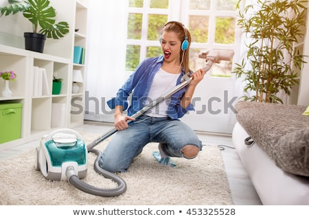 Little girl with vacuum cleaner Stock photo © IS2