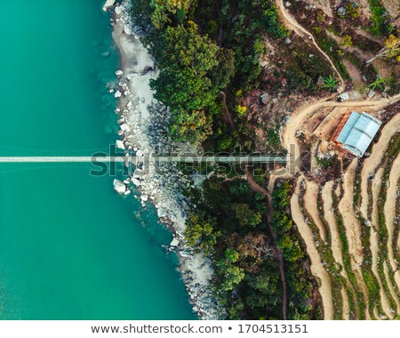 drone view of suspension bridge in nepal stock photo © dutourdumonde